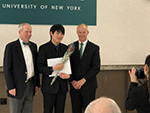 Dong Woo Shin with Binghamton University president and provost receiving his award.