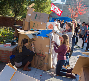 Lindsey Boody, Anna Shapiro and Katja Anuth of Phi Delta Epsilon, build a haunted house themed cardboard home during at the 2nd annual Shack-A-Thon, which raised funds and awareness for Habitat for Humanity, Monday, Oct 19, 2015.
