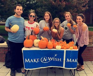 Wishmakers on Campus sell pumpkins to raise money and awareness for the Make a Wish Foundation.