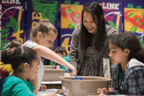 Jessica Hua, assistant professor of biological sciences, shares her research on the interplay of toxicology, ecology and evolution with local third graders.