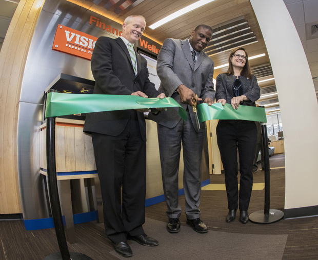 President Harvey Stenger; Tyrone Muse, president/CEO of Visions Federal Credit Union; and Kelli Smith, director of the Fleishman Center for Career and Professional Development, cut the ribbon during a Jan. 19 ceremony opening the Financial Wellness Center.
