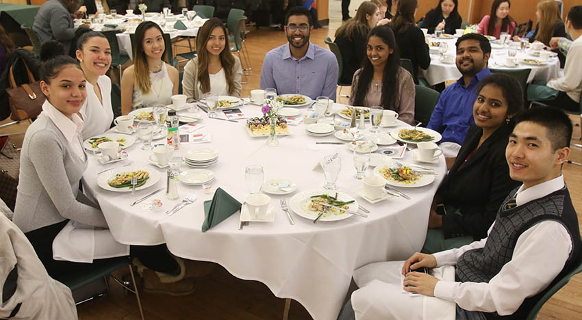 Students around table at 2018 Etiquette Dinner