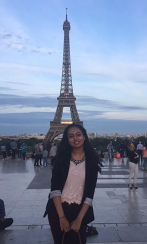 Priya in front of the Eiffel Tower