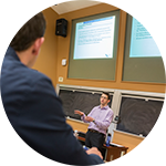 Faculty member teaching in the Lecture Hall.