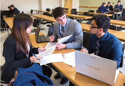 Binghamton students collaborating on a project.