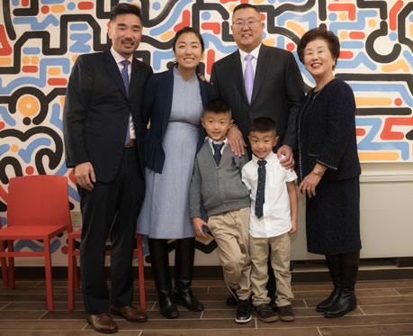 Charles Kim, right, with his brother, wife, mother and children.