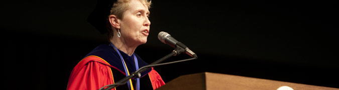 Dean of the Graduate School addressing students during commencement