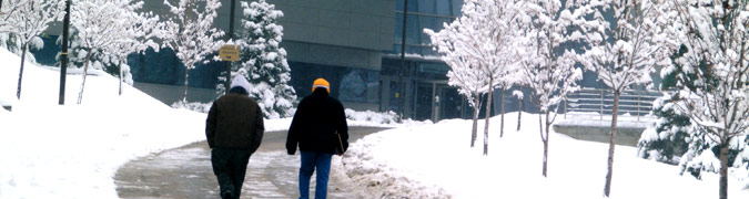 Students walking on a snow covered campus
