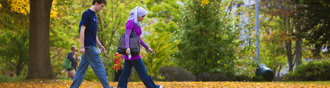 Students walking across campus during the fall months