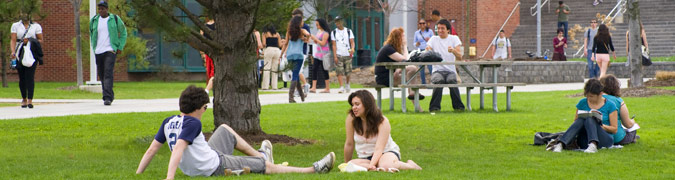 students enjoying nice weather outside in front of the university union