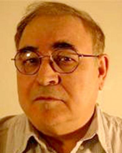 headshot of Haim Ofek