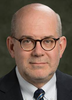 headshot of Mark D. Poliks