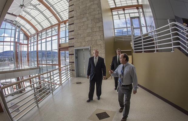 William Hall, architectural supervisor at Physical Facilities, gives a tour of the nearly completed Center of Excellence building at the Innovative Technologies Complex to President Harvey Stenger and NYSEG President/CEO Mark S. Lynch after NYSEG presented two checks of $400,000 from its Utility Infrastructure Investment Program.