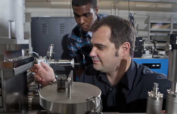 Louis Piper, assistant professor of physics, with a student in the Analytical and Diagnostics Laboratory.