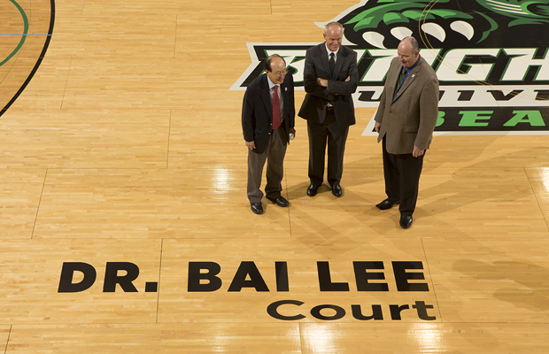 Left to right, Dr. Bai Lee, Binghamton University President Harvey Stenger and Director of Athletics Patrick Elliott stand on the basketball court in the Events Center, which is being named in honor of Lee for his gift of $1 million to support the University's Athletics Department.