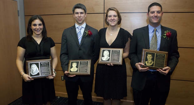 Hall of Fame inductees Jamie Kissel '00, left, Chris McGuire '04, Sarah Cartmill '02 and Adam Fuchs '03, right, display their plaques during a ceremony held Oct. 8 in the Tau Bearcat Room at the Events Center,