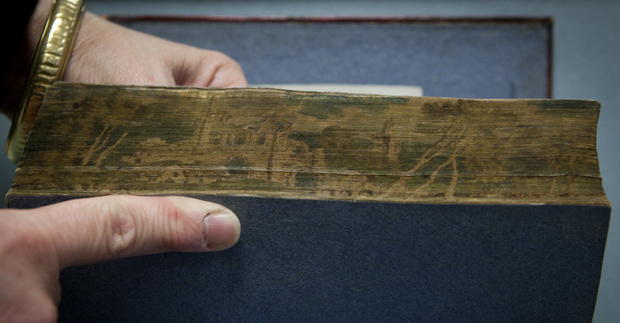 <em>The Book of Common Prayer</em>, with its disappearing fore-edge painting of the ruins of Byland Abbey, North Yorkshire, is stored in the Special Collections section of the Glenn G. Bartle Library.