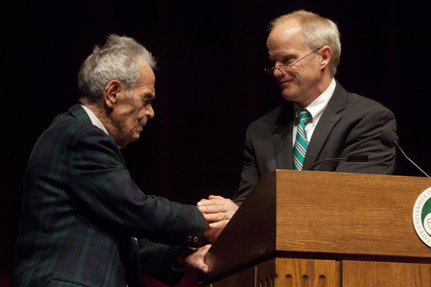 Abraham J. Briloff, Presidential Professor of Accounting and Ethics at Binghamton University and Emanuel Saxe Distinguished Professor Emeritus at Bernard Baruch College, is greeted by President Harvey Stenger at the Abraham J. Briloff Lecture on Accountability and Society on March 29.