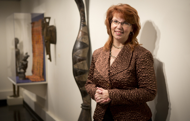 Diane Butler, new University Art Museum director, stands in the museum located in the Fine Arts Building.