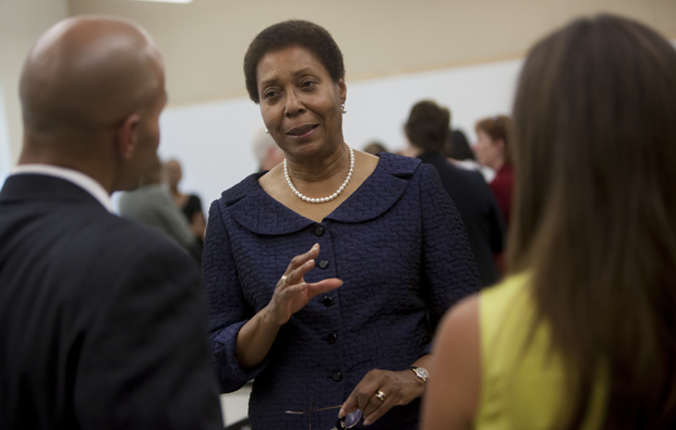 Josephine Allen, professor of social work and director of the new doctoral program in Community and Public Affairs, talks with guests during the program launch on Aug. 26.