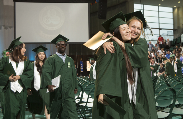 Decker School of Nursing students Cuiting Chen and Caileigh O'Rourke embrace at the end of the school's Commencement ceremony on May 21.