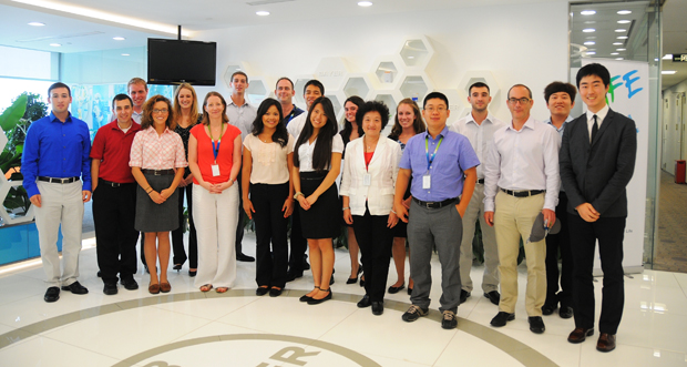 "Xiujian ""Jerry"" Chen (in purple shirt), visiting assistant professor in the School of Management, led a class trip to China in August, which included a visit to a Bayer facility."