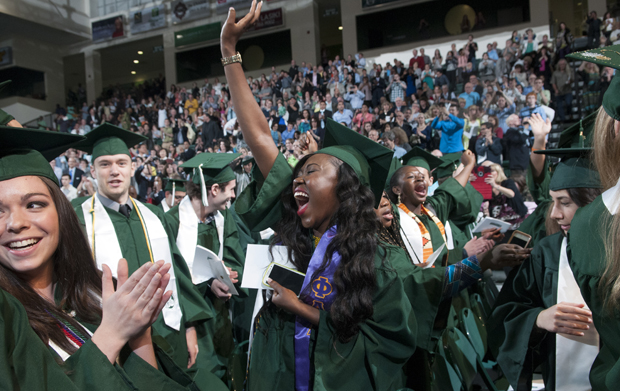 Cynthia Amoah, left,  Anita Matey, center, and other students celebrate their graduation from Binghamton University during the Harpur College of Arts and Science's social sciences ceremony in the Events Center on May 19.