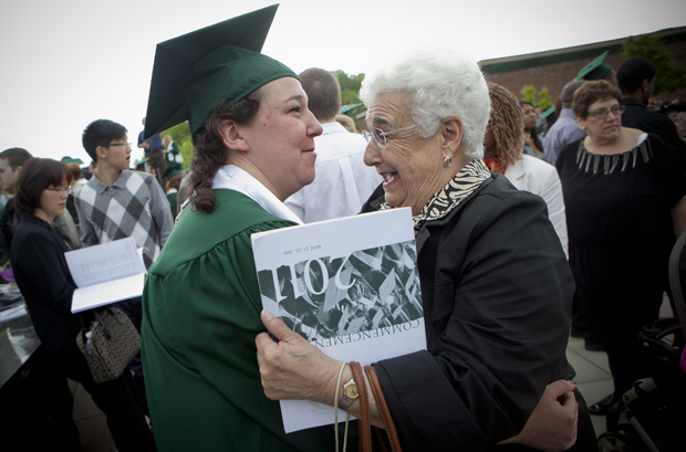 Jaclyn Pedowicz, who received a degree in English, hugs her grandmother, Bea, from Floral Park, following the Harpur College morning ceremony at the Events Center on May 22.