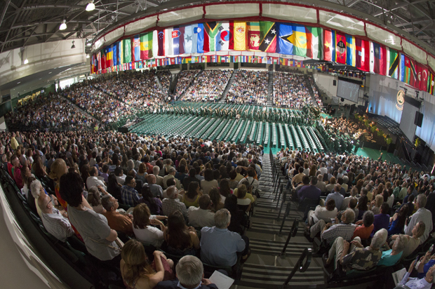 Students walk across the Events Center floor during a Harpur College Commencement ceremony in 2015. This year's ceremonies take place from May 20-22.