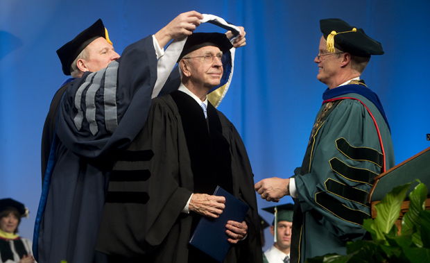 James Carrigg, retired CEO of New York State Electric & Gas Corp. and founding member of the Watson School of Engineering and Applied Science, receives an honorary degree from Provost Donald Nieman, left, and President Harvey Stenger.