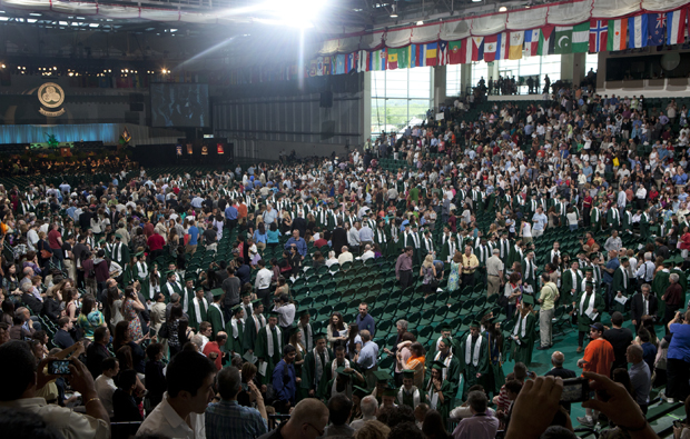 The Commencement audience watches as graduates leave the Events Center during a ceremony last May.