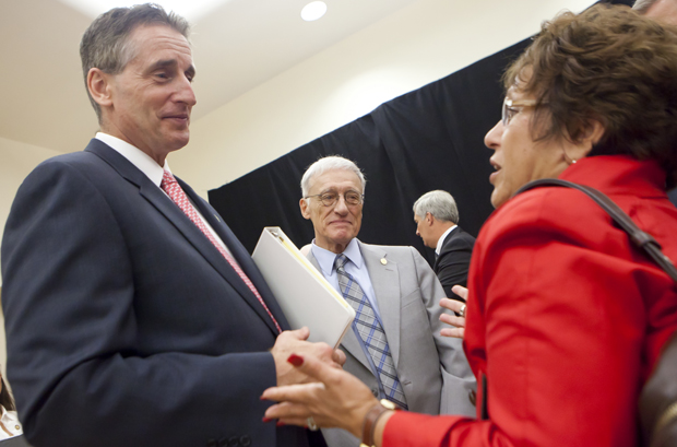 Lt. Gov. Robert Duffy and Binghamton University President C. Peter Magrath talk with Barbara Fiala, state Department of Motor Vehicles commissioner, following the launch of the Southern Tier Regional Economic Development Council in the Mandela Room on July 27.