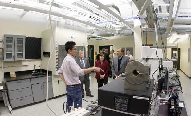 State Sen. Thomas Libous, right, State Assemblywoman Donna A. Lupardo and Broome County Executive Patrick J. Brennan tour the Optomechanics Lab at the opening of the new Engineering and Science Building with guidence from Yeon-Sung Kim, a third-year doctoral student working on MEMS packaging.