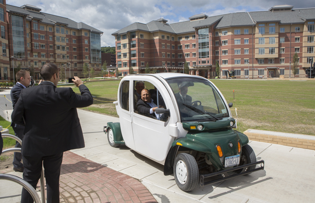 President Harvey Stenger and state Sen. Thomas Libous (in passenger side of car) prepare to take a tour of some of the buildings that are part of the East Campus Housing project.
