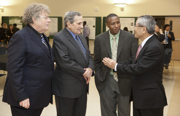 Distinguished Professor John Eisch, second from left, talks with Ordinarius Professor Udo Brinker of the University of Vienna, left, John Gitua, PhD '95, and 2010 Nobel Prize winner Ei-ichi Negishi, right, at the John Eisch Organometallic Symposium in Old Union Hall.