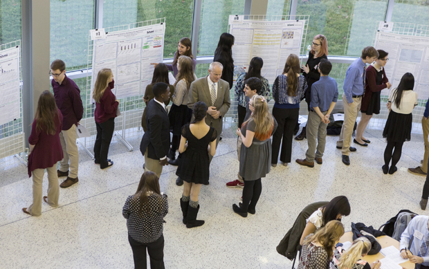 Students of the Freshman Research Immersion (FRI) program present their research at a poster session in the Engineering and Science Building at the Innovative Technologies Complex on Dec. 7.
