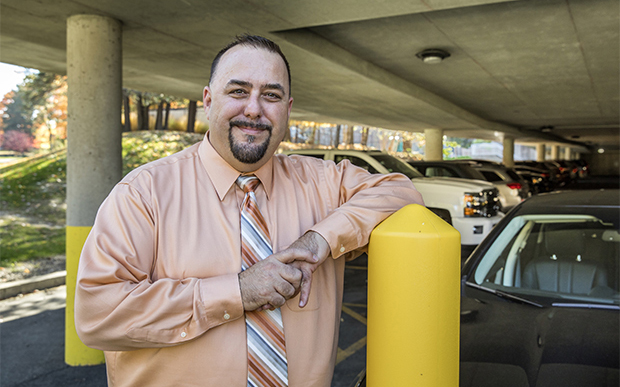 Brian Favela, executive director of transportation and parking services, stands in the University's parking garage.