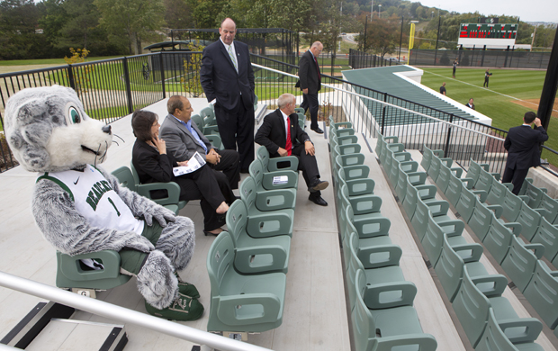 President Harvey Stenger, Director of Athletics Patrick Elliot, state Sen. Thomas Libous, state Assemblywoman Donna A. Lupardo and Baxter the Bearcat take in the view of the new softball stadium on Sept. 21. The baseball stadium and tennis courts also received renovations.