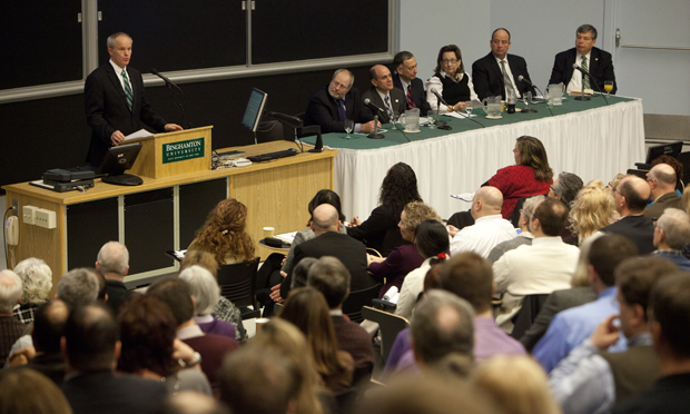 The vice presidents and audience members watch as President Harvey Stenger speaks at the University Forum on Jan. 24.