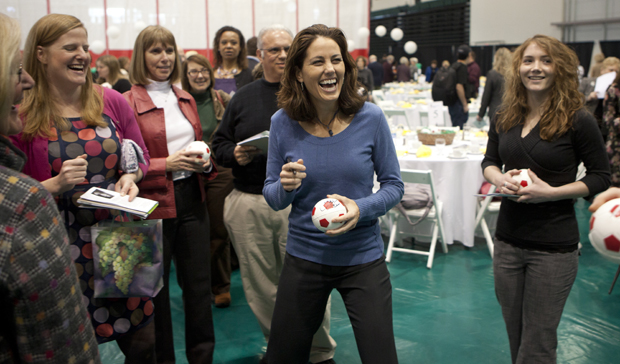 Julie Foudy, center, a former captain of the U.S. Women's National Soccer Team, autographs a mini soccer ball at the 6th Annual Bearcats Celebrating Women's Athletics Luncheon and Auction at the Events Center on Feb. 7.