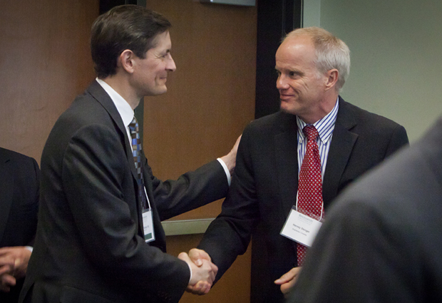 President Harvey Stenger, right, shakes hands with Robert Kump '83, chief executive officer of Iberdrola USA, during Energy Innovation Day on campus on April 17. The Iberdrola USA Foundation has given a $100,000 gift to The Thomas J. Watson School of Engineering and Applied Science.