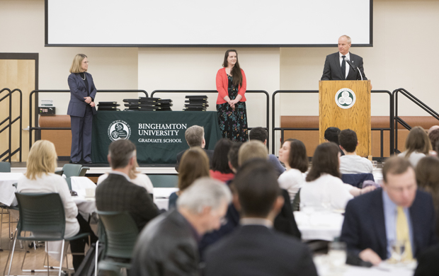 President Harvey Stenger salutes the recipients at the Graduate Excellence Awards on March 28.