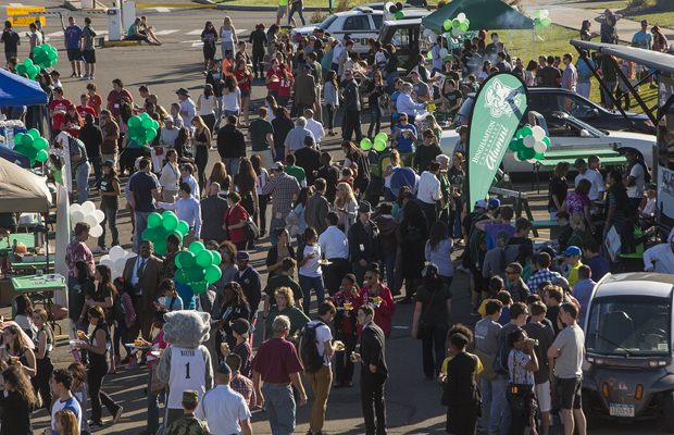 Alumni and other members of the campus community take part in Tailgate '13 outside the Events Center on Oct. 12.