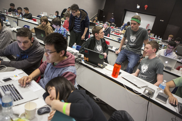 Dan O'Connor, a computer science major, center, Chris Beard, left, and Jack Fischer lead the first HackBU Hackathon in Academic Building A on April 26.