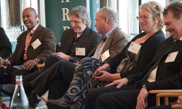 "From left, Ruben Santiago-Hudson '78, Marc Lawrence '81, Andrew Bergman '65, Madeleine Smithberg '81 and Steve Luckert '80, MA '83, PhD '93, share a laugh during ""Bold Ideas. Brilliant Careers. 60 Years of Harpur College"" at the Lincoln Center in New York City on Nov. 14."