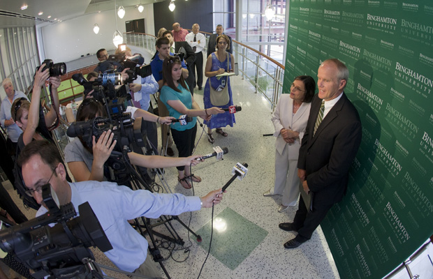 Binghamton University President Harvey Stenger, accompanied by Assemblywoman Donna Lupardo, speaks to the media following Gov. Andrew Cuomo's approval of Binghamton's NYSUNY 2020 plan.