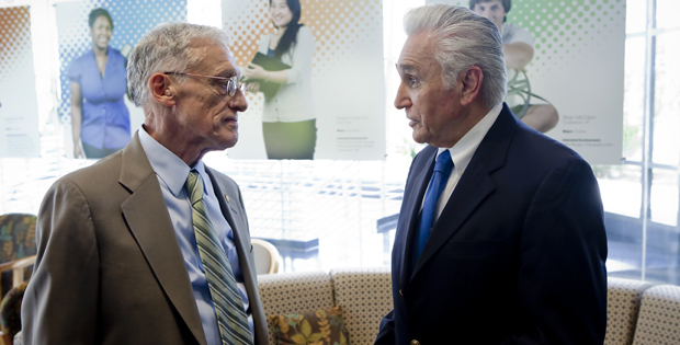 Interim President C. Peter Magrath, left, and U.S. Rep. Maurice Hinchey speak before a news conference in the Admissions office Aug. 30 on how financial-aid improvements are helping students and families.