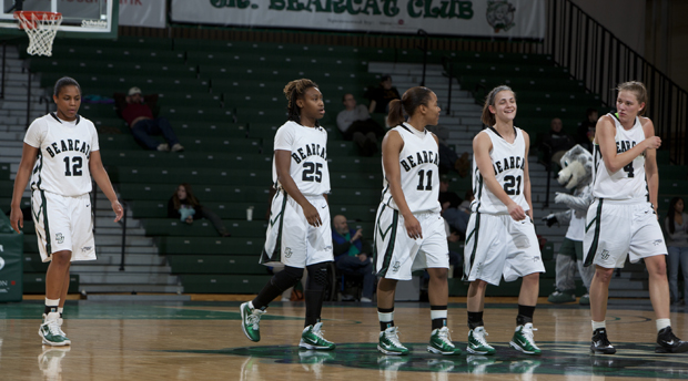 From left: Kara Elofson (12), Jasbriell Swain (25), Jackie Ward (21), Andrea Holmes (11) and Viive Rebane (4) walk up the court during the victory over Albany at the Events Center on Jan. 20.