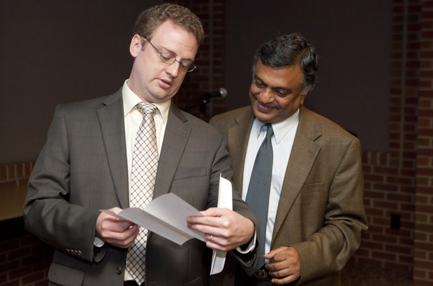 Professors Scott Craver, left and Nagen Nagarur read a letter explaining the IBM Faculty Awards they received during  a presentation held in the Anderson Center President's Reception Room on Aug. 22.