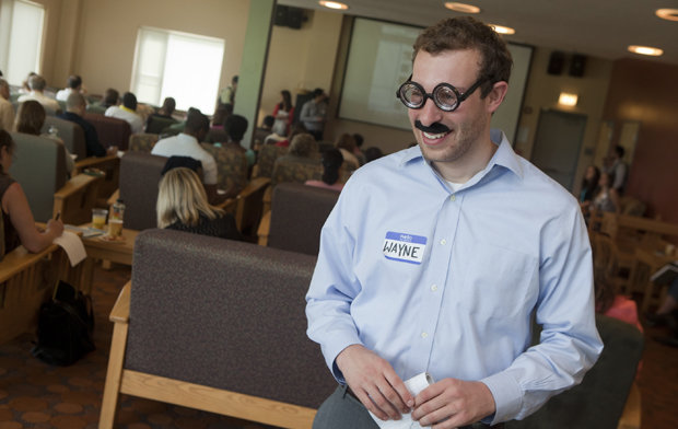 Aaron Cohn, a freshly minted Binghamton University graduate, provided some comic relief when he welcomed participants to the Institute for Student Centered Learning workshop May 21, dressed as Wayne Jones, professor of chemistry, who traditionally opens the annual workshop.
